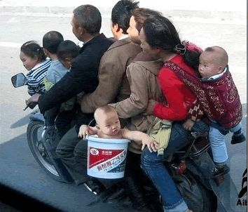 thai family on motorbike